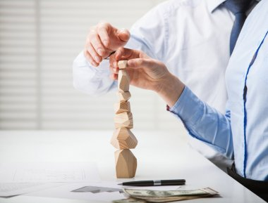 Business people building wooden tower