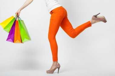 Woman holding multicolored shopping bags