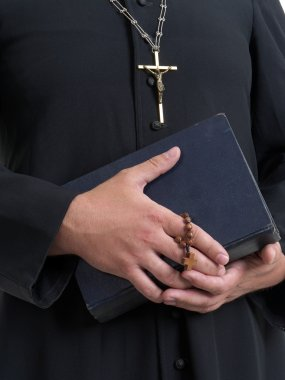 Priest with bible and rosary