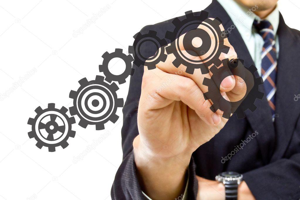 Businessman writing Gear group