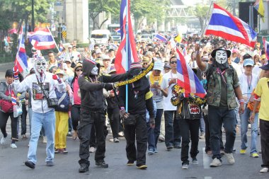 BANGKOK - DEC 9: Many Masked protesters walked for anti governme