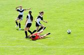 Fényképek játék futball-lányok