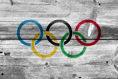 Olympic Flag painted on old wood plank background