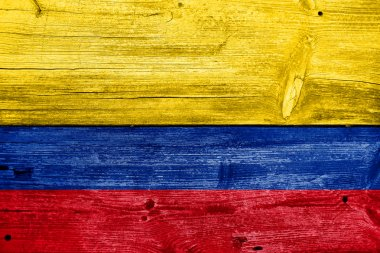 Colombia Flag painted on old wood plank background