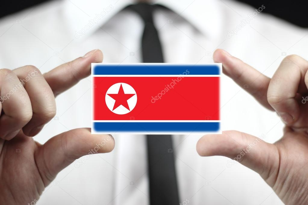 Businessman holding a business card with a north korea flag stock businessman holding a business card with a north korea flag photo by promesastudio reheart Gallery