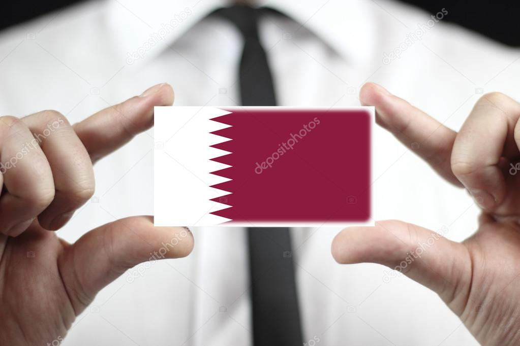 Businessman holding a business card with qatar flag stock photo businessman holding a business card with qatar flag photo by promesastudio reheart Choice Image