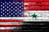 vlajka USA a Sýrie na zdi malované