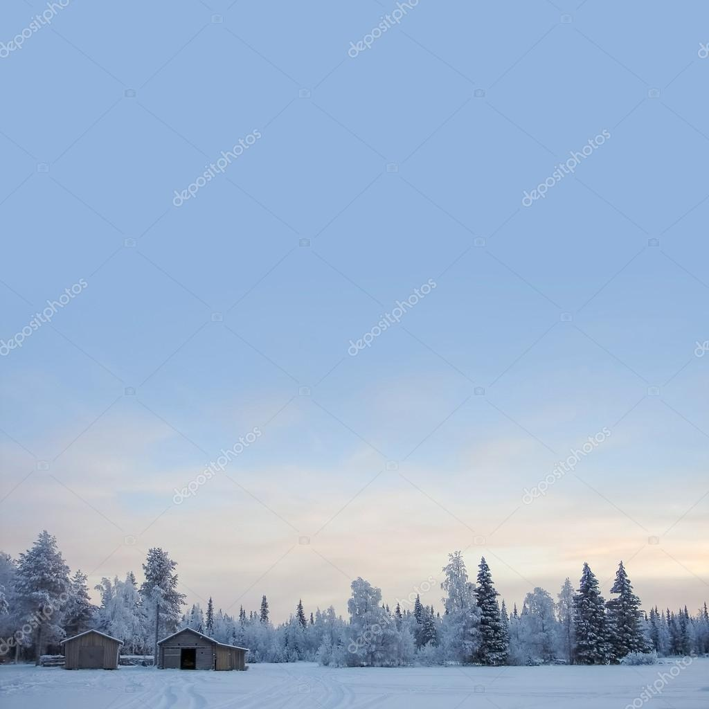Winter background with cabin and copyspace on sky