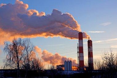 Factory chimneys smoke rising into the sky