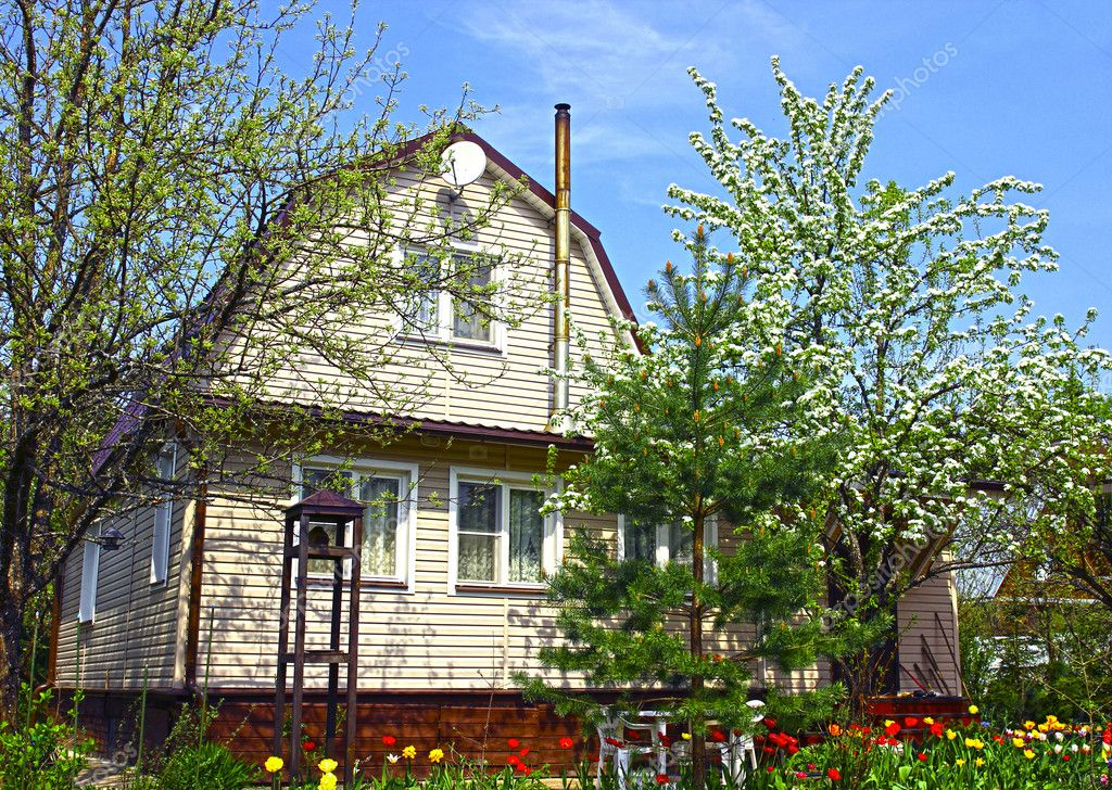 Garden house surrounded by blossoming trees