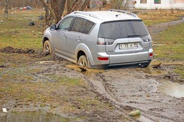 Car stuck in the mud Mitsubishi Outlander
