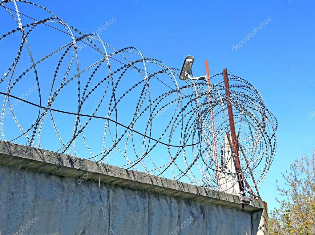 Fence with barbed wire and surveillance cameras — Stock Photo ...