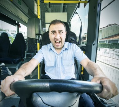 Bus driver with scared face.