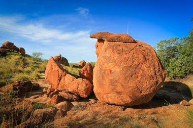 Granite eroded red rock formation, Devils Marbles, Australia