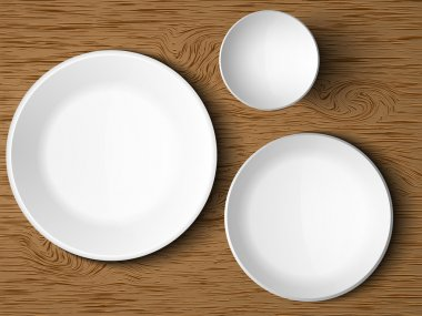 A set of white dishes on a wooden table stock vector