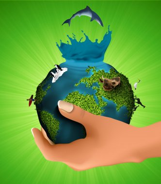 Green planet with the animals in his hand. concept of ecology