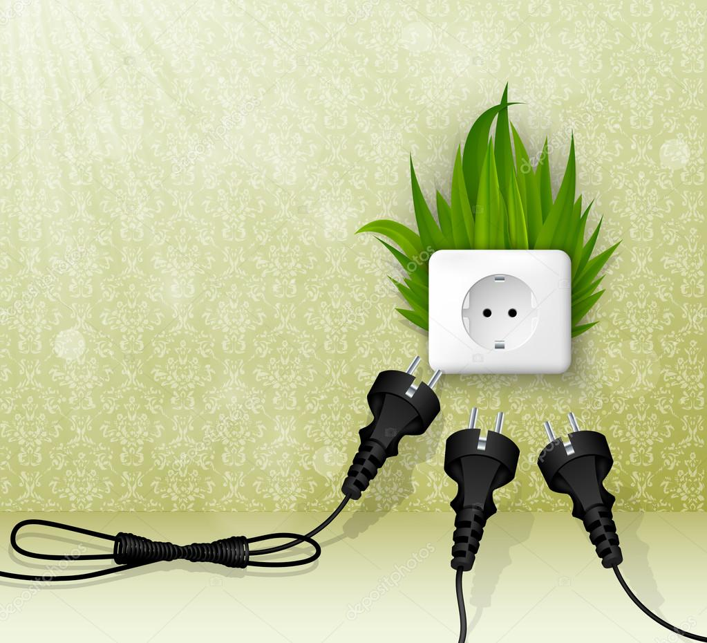 Green grass and a socket with plugs. the concept of clean energy