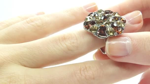 Jewelery ring with bright gem putting on the finger