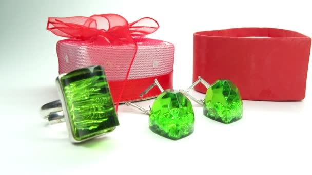 Jewelery emerald ring and earrings in red box as present