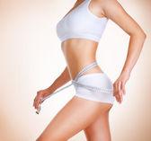 Photo Woman measuring her waistline. Diet. Perfect Slim Body