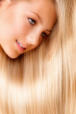 Beautiful Blond Long Hair. Blonde Girl Close-up Portrait