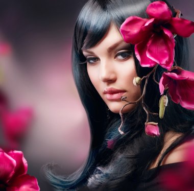 Fashion Brunette Girl with Magnolia Flower