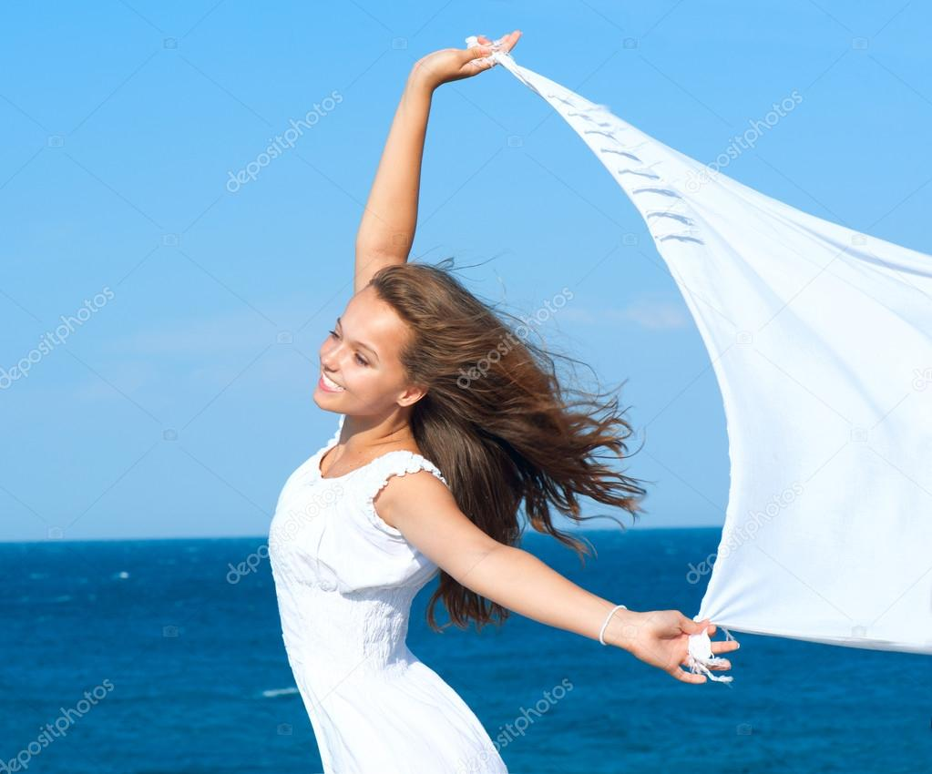 Girl With White Scarf on The Beach. Travel and Vacation