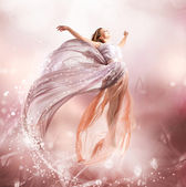 Photo Fairy. Beautiful Girl in Blowing Dress Flying. Magic