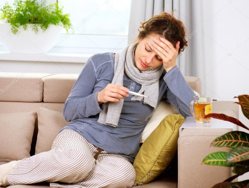 Sick Woman with Thermometer. Headache. Flu