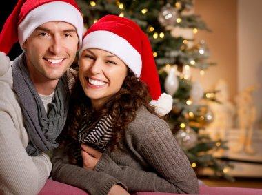 Christmas. Happy Couple at home celebrating Christmas