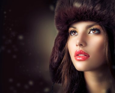 Beautiful Young Woman in a Fur Hat. Winter Style