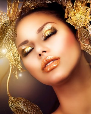 Fashion Glamour Makeup. Holiday Gold Makeup