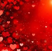 Fotografia Priorità bassa rossa astratta di cuori di San Valentino. Giorno di St. Valentine