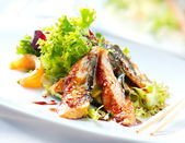Fotografie Salad With Smoked Eel with Unagi Sauce. Japanese Food