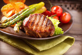 Fotografie Grilled Beef Steak Meat with Vegetables
