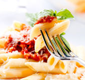 Fotografie Penne Pasta with Bolognese Sauce, Parmesan Cheese and Basil