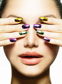 Photo Manicure and Make-up. Nail art. Beauty Woman With Colorful Nails