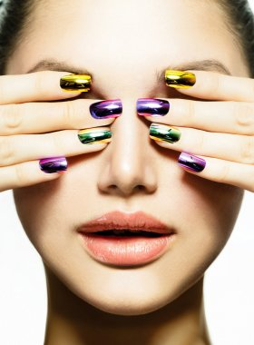 Manicure and Make-up. Nail art. Beauty Woman With Colorful Nails