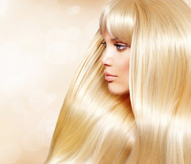 Blond Hair. Fashion Girl With Healthy Long Smooth Hair