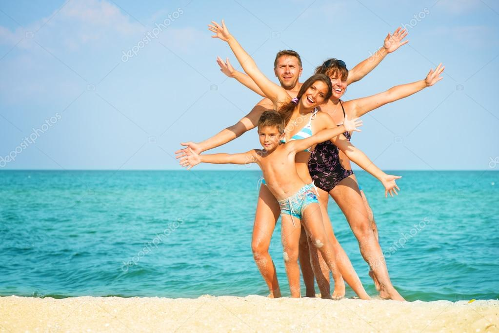 Happy Family Having Fun at the Beach. Vacation