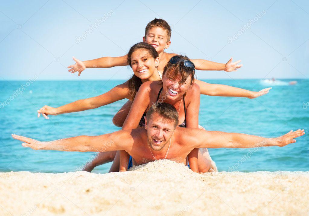 Happy Family Having Fun at the Beach. Summer Holidays