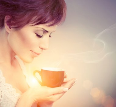 Beautiful Girl Enjoying Coffee. Woman with Cup of Hot Beverage