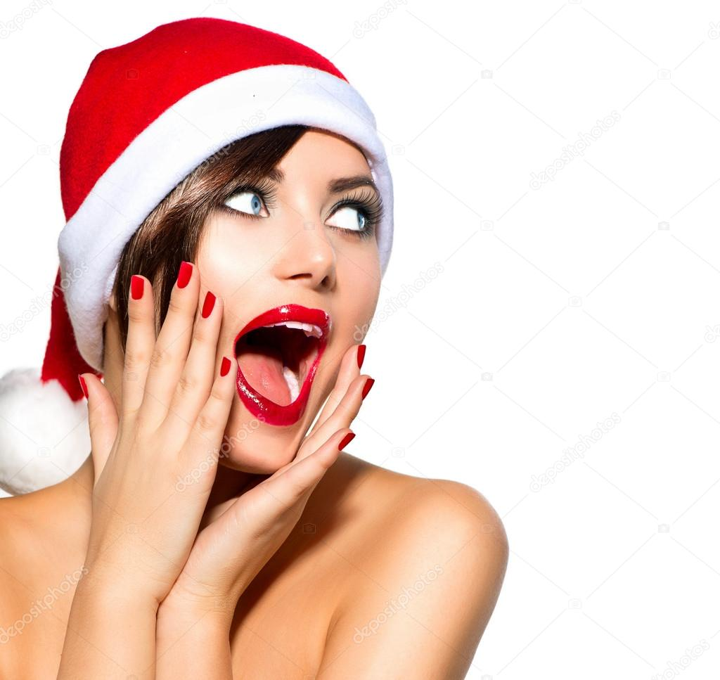Christmas Facial.Christmas Woman Beauty Model Girl In Santa Hat Stock Photo