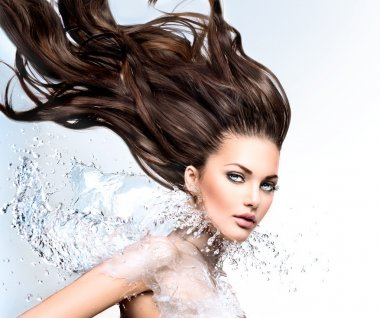 Model with water splash and long  hair