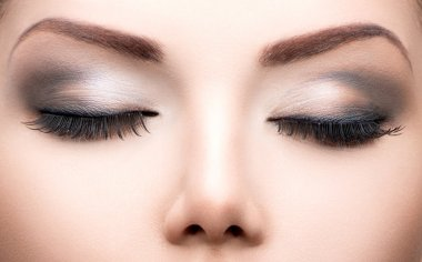Beauty eyes makeup closeup.