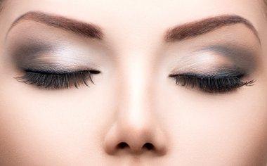 Beauty eyes makeup closeup.