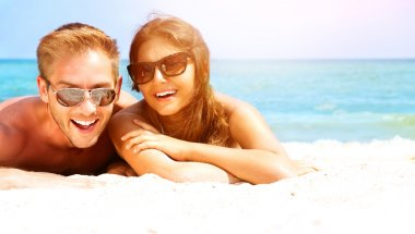 Couple in Sunglasses  on the Beach.
