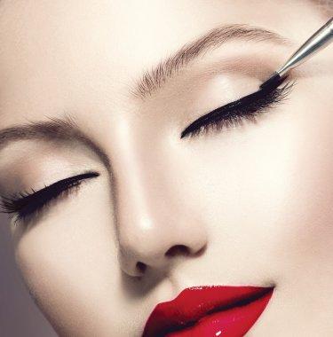 Make-up Applying closeup. Eyeliner