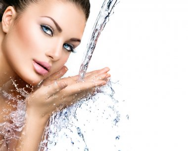 Model woman with splashes of water
