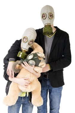 Children with toy in gas mask